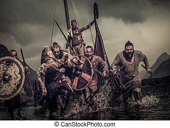 Mad vikings warriors in attack, running along shore with...