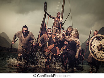 Mad vikings warriors in the attack, running along the shore ...