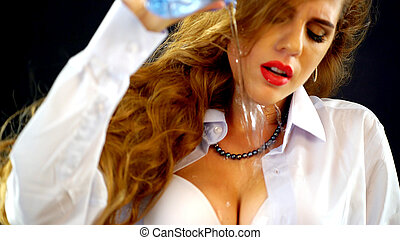 Mad woman drinking water from bottle ,pours on breasts and stomach.