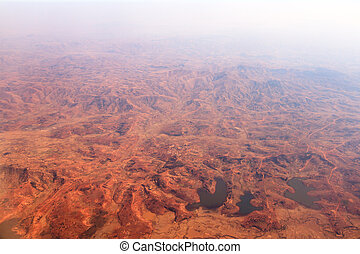 Aerial view of the deforestation of Madagascar, showing a red and empty landscape