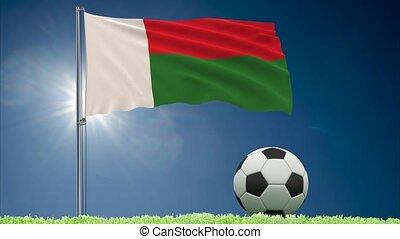 Madagascar flag fluttering and football rolls - Flag of...