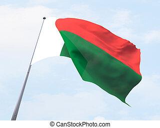 Madagascar flag flying on clear sky.
