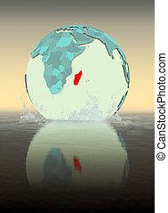 Madagascar on globe splashing in water