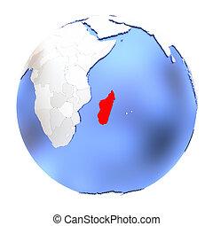 Madagascar on metallic globe isolated