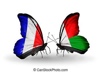 madagascar, símbolo, dos, relaciones, francia, mariposas, banderas, alas
