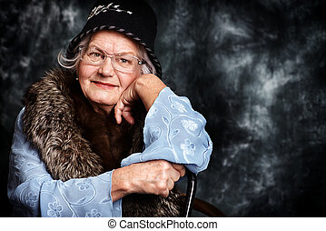 madam style - Portrait of a beautiful old lady in an elegant...