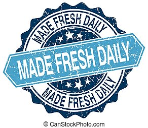 made fresh daily blue round grunge stamp on white