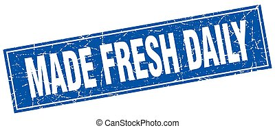 made fresh daily blue square grunge stamp on white