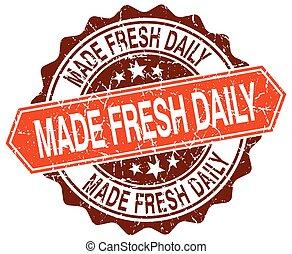 made fresh daily orange round grunge stamp on white