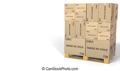 MADE IN CHILE text on boxes on a pallet. Conceptual 3D...
