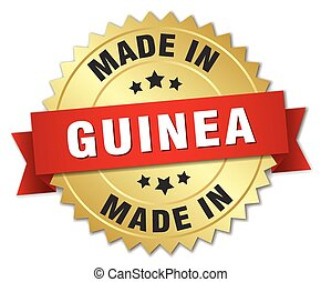 made in Guinea gold badge with red ribbon