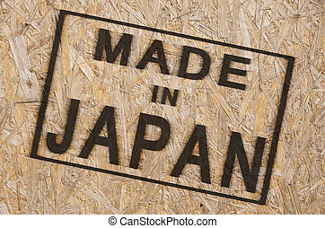 Made in JAPAN - close-up of a brown pressed wood textured ...