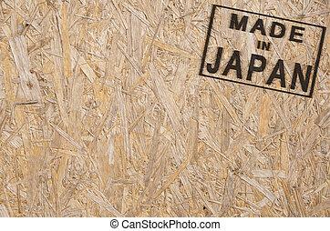 Made in JAPAN corner - close-up of a brown pressed wood ...