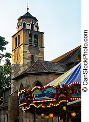 Madeleine Church and fragment of carrousel in Geneva -...