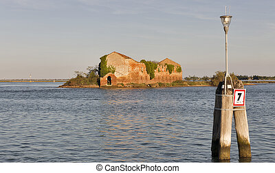 Madonna del Monte island in Venice lagoon at sunset, Italy.