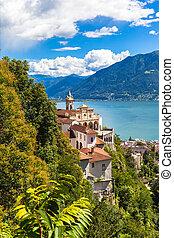 Stunning view of Madonna del Sasso Church above Locarno city and the Maggiore lake on a summer day in Ticino, Switzerland
