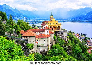 Madonna del Sasso Church over Lago Maggiore lake and swiss Alps mountains, Locarno, Switzerland