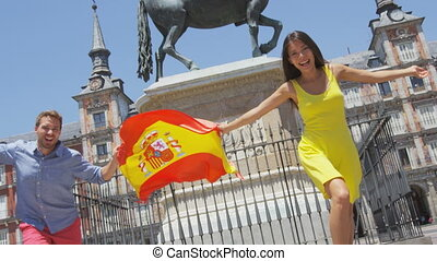 Madrid people showing Spain flag on Plaza Mayor cheerful and...
