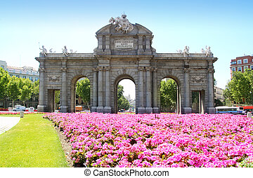 Madrid Puerta de Alcala with flower gardens in Spain