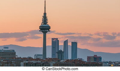 Madrid skyline timelapse with some emblematic buildings such as Kio Towers, part of the Cuatro Torres Business Area and the Piruli TV Tower.