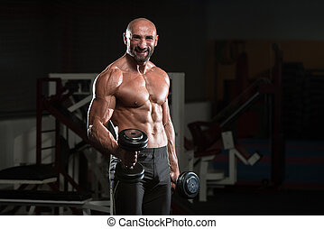 maduras, bodybuilder, exercitar, bíceps, com, dumbbell