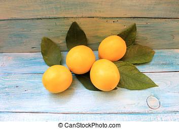 maduro, amarillo, limones, con, hojas