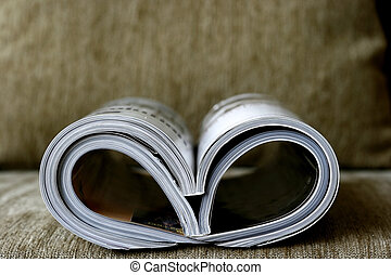 Magazine rolled shaped into hearth in a cosy sofa
