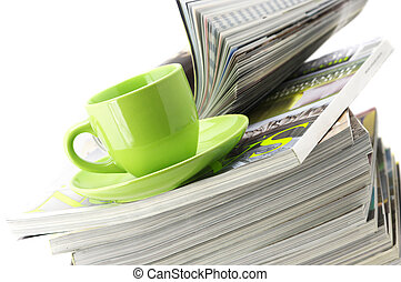 Magazines and coffee cup - Stack of magazines and green cup ...