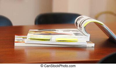 Magazines - opened magazines on brown business desk indoor