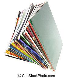 Magazines - Pile of colorful magazines isolated over white...