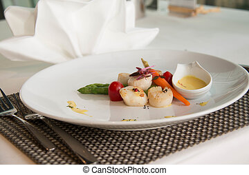 gourmet seared scallops with garnishes.
