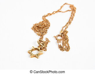 Magen David gold necklace closeup
