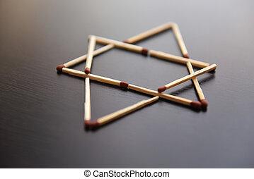 Magen David, Israel word from matches. Magen David, Israel from matches on a black wood. Concept of matches magen David, Israel.