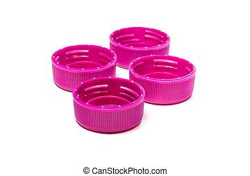 Magenta plastic bottle caps