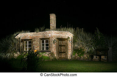 Magic brick hut at night