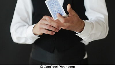 man showing trick with playing cards