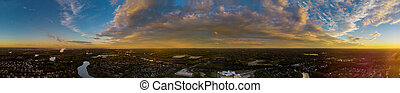 Magic color full sunset sky with clouds over the city at sunset.