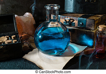 Magic concept. Blue Potion in bottle and wooden box