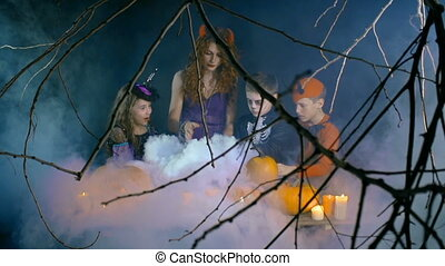 Magic Evaporation - Group of four people in Halloween...