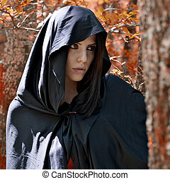 Magic fantasy atmosphere of woman with hood - Beautiful...