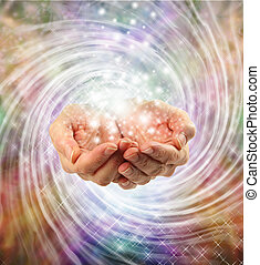 Female cupped hands emerging from twirling energy field with multicolored background and sparkles