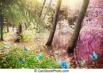 Magic forest with butterfly at sunrise