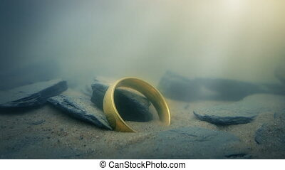 Magic Gold Ring Glowing Underwater - Magical golden ring...