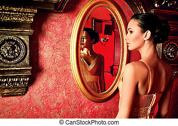 magic mirror - Beautiful young woman in a luxurious classic...