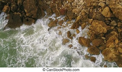 Magic movements and splashes of waves on the rocks of the shores, Atlantic Ocean.