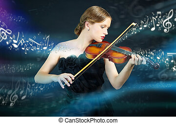 Magic music - Portrait of a young female playing the violin...