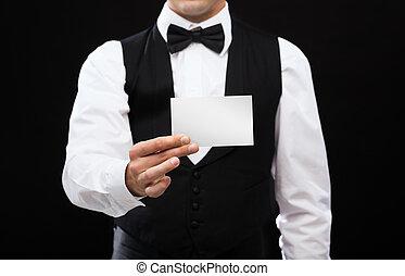 dealer holding white card