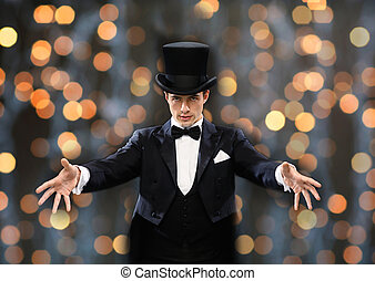 magician in top hat showing trick - magic, performance,...