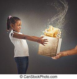 Magic present sparkling - Little girl receives a magic ...