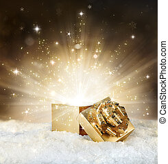 magic shining of christmas gift - golden stardust and snow